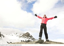 Woman shouting from snowy mountain top