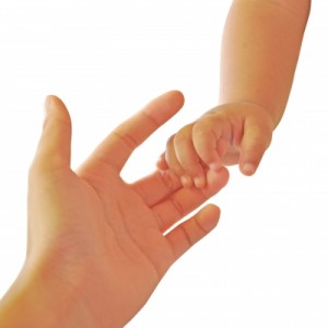 Baby's Hand Holding Mother's Finger by gubgib, www.freedigitalphotos.net